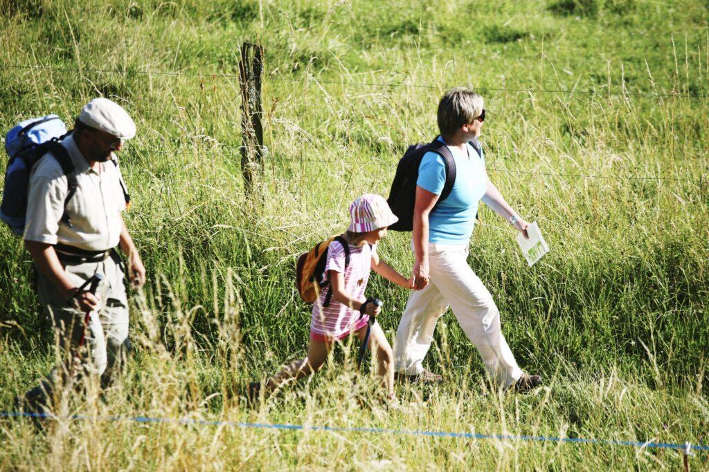 family walk on the paths around les hauts de saint vincent